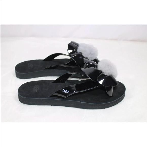 897a12ae00d UGG Poppy Flower Flip Flops Pom Pom Black Sandals NWT